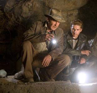 indiana jones in cave with flashlight