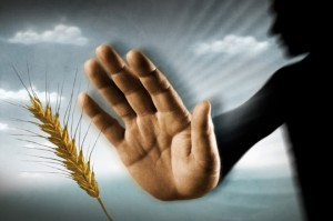 hand pushing grain away