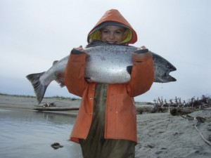 kid holding a fish
