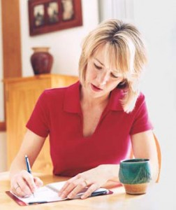woman writing in food journal