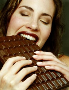 fit woman eating chocolate