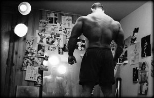 bodybuilder in front of mirror