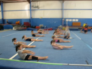 carson-city-gymnastics-class-hollow-body-practice-300x225