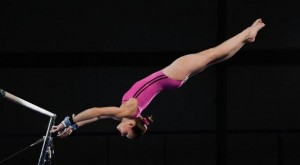 Female gymnast on gymnastics bar